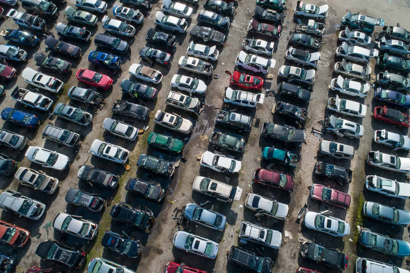 birds eye view of a salvage junk yard full of cars