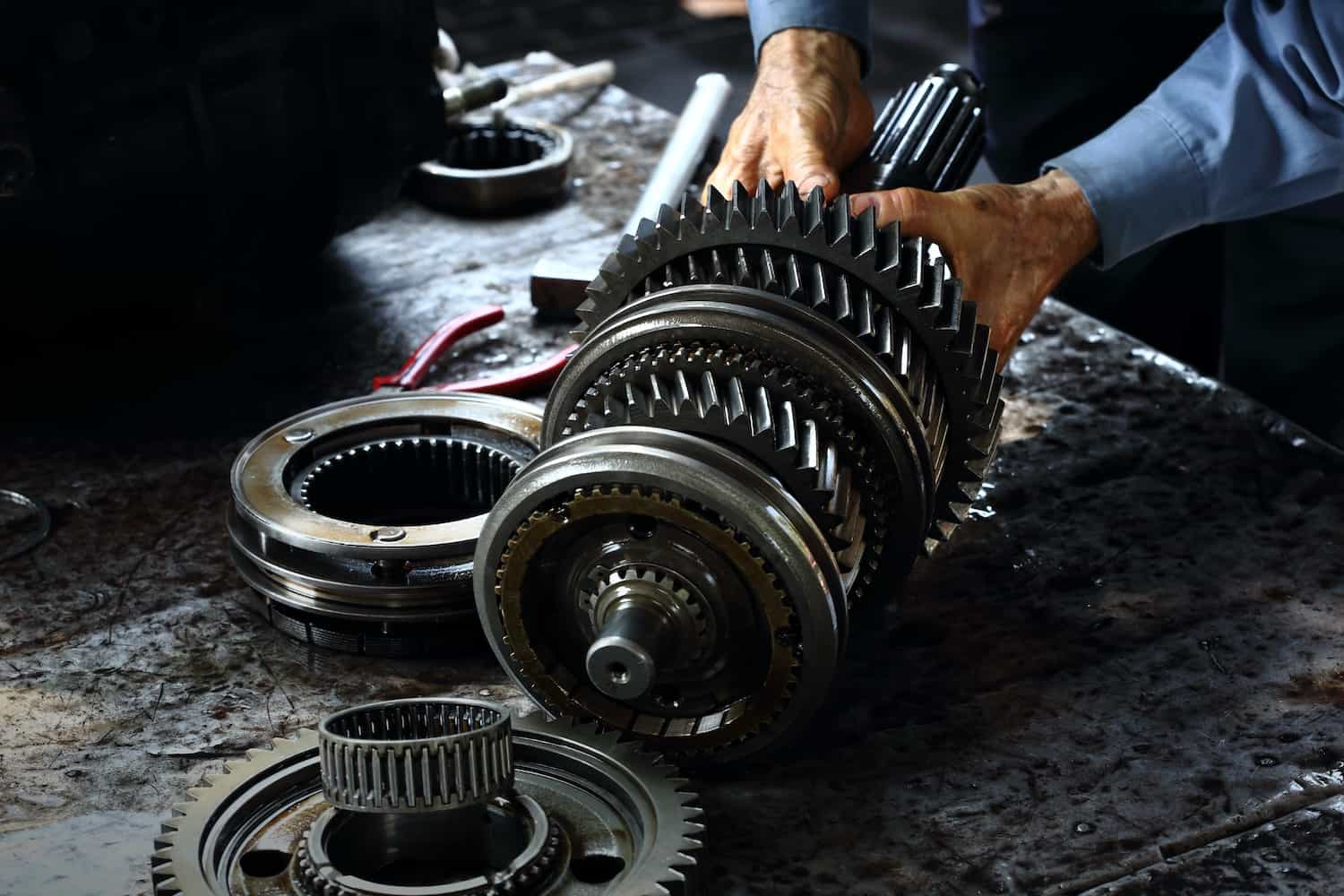 mechanic working with a used transmission
